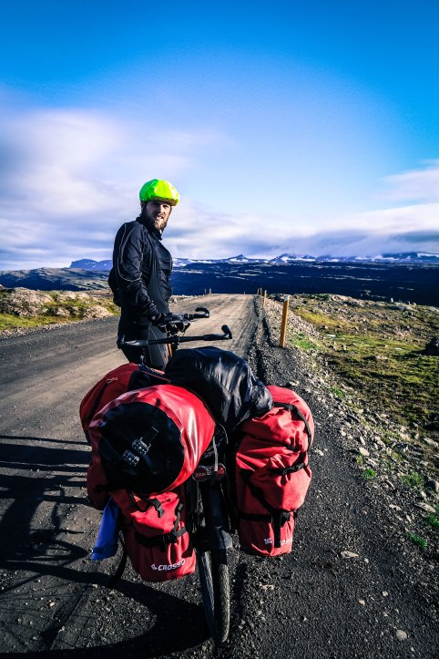 A man on a tandem bicycle at the Oxi Pass, in Iceland