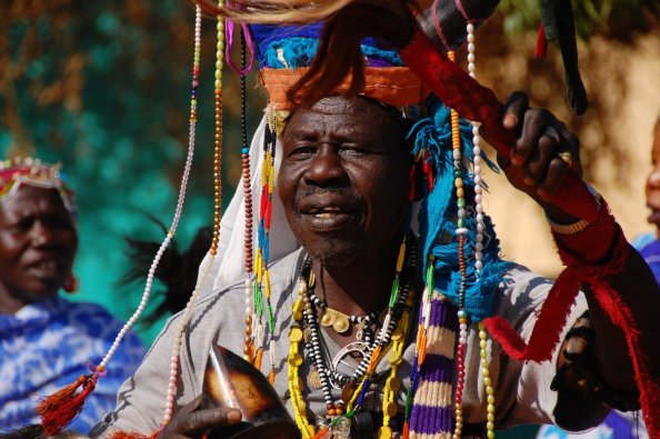 Bagara tribe man in traditional outfit doing magic in Sudan