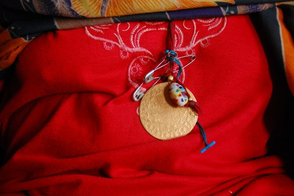 Sheikha's medallion and the red outfit for magic in Sudan