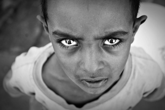 black and white photo of a Sudanese boy