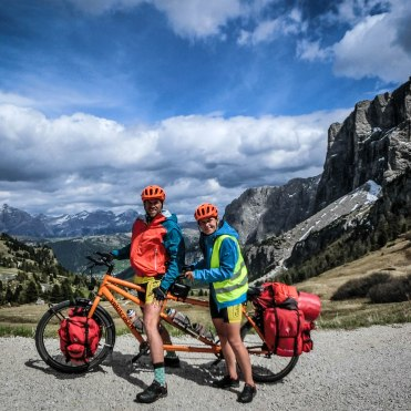 tandem bicycle with two riders in the mountains