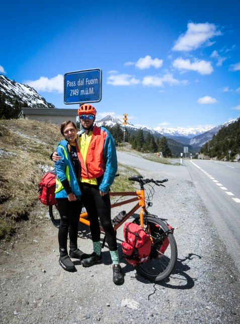 Bicycle rider couple in front of a tandem bicycle at the Pass dal Fuorn / Ofen Pass