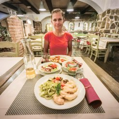 a woman sitting in a dinner table at Hotel Grajski Dvor