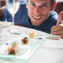 A man showing thumbs up at a restaurant