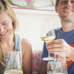A happy couple in a restaurant drinking wine