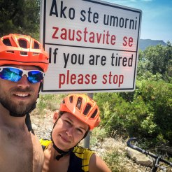 a bicycle couple in front of a street sign