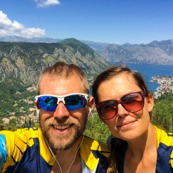 A happy bicycle couple with sunglasses in the mountains