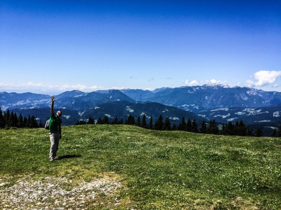 A waving man in the Slovenian mountains