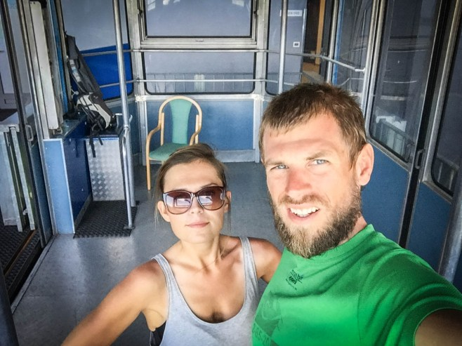 a couple in a cable cart