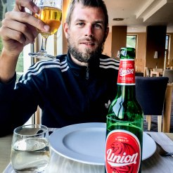 A man toasts with beer at the Golte Resort