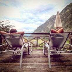a man and a women laying on loungers