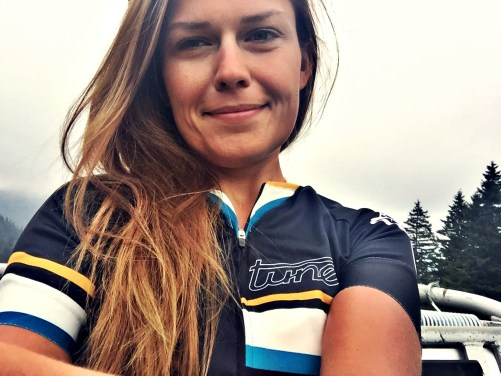 Woman bicycle rider with long hair wearing a cycling trikot / Packing Tips For Cycling Women