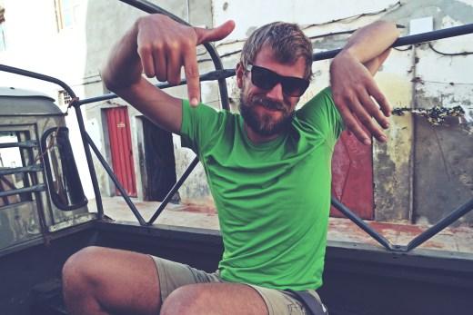 Blonde German man hitchhiking through Western Sahara in Morocco