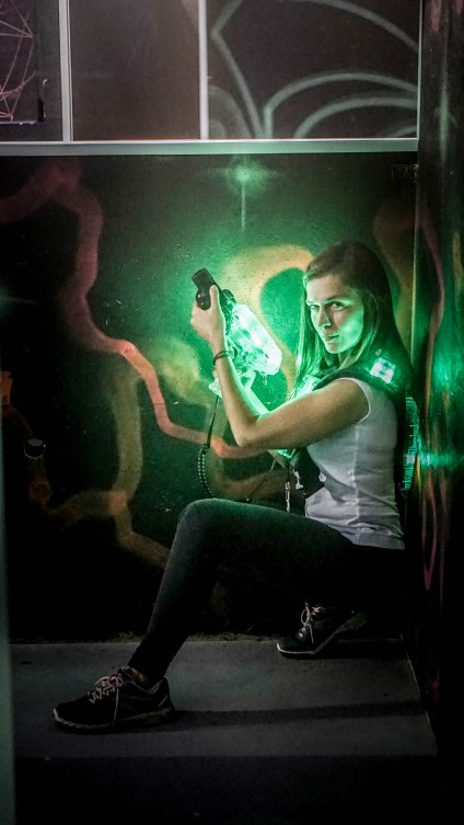 A sexy woman with a lasertag gun