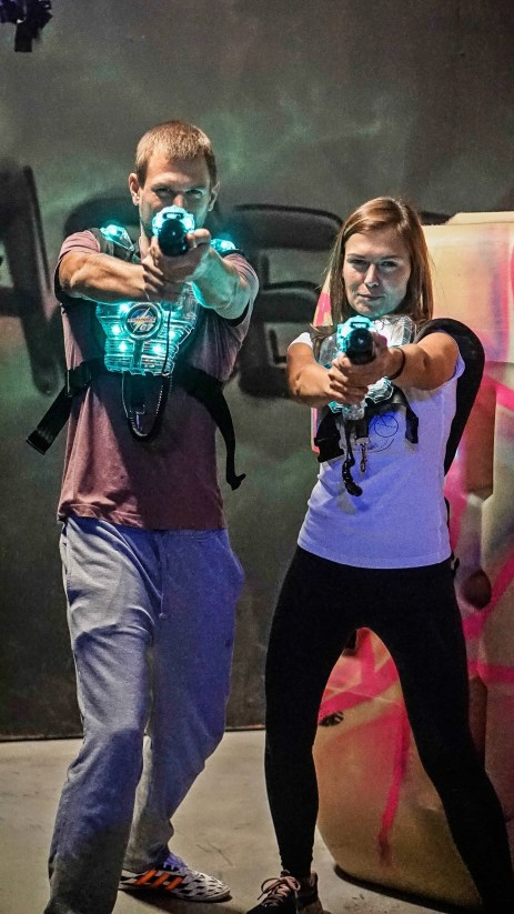 man and woman with a lasertag