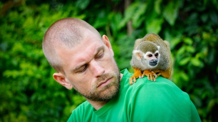 A man with a monkey on the shoulder