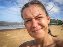 Selfie of a smiling woman on a beach on French Guiana