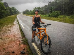 woman on a tandem bicycle in jungle / Cycling through South America