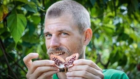 Man eating kusuwe fruit