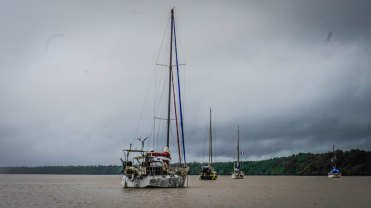 sailing ships on a river at the French Guiana Ilet la Mere