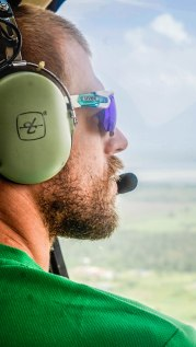 a man in a helicopter cockpit at Paramaribo Helicopter Flight