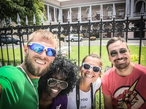 selfie of four happy people on a Georgetown Walking Tour in Guyana