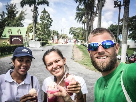 three happy people eating ice cream during a Georgetown Walking Tour in Guyana