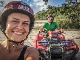 man on a quad and a woman in front
