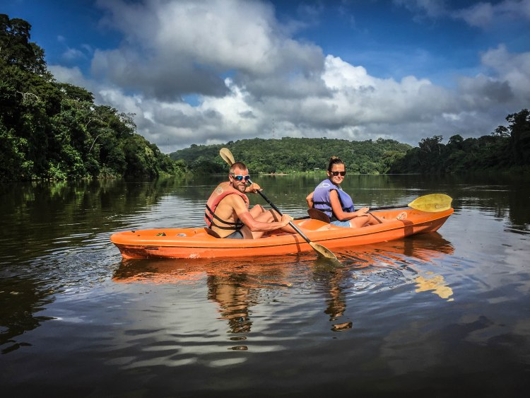 man and woman on a 2-person tandem kayak