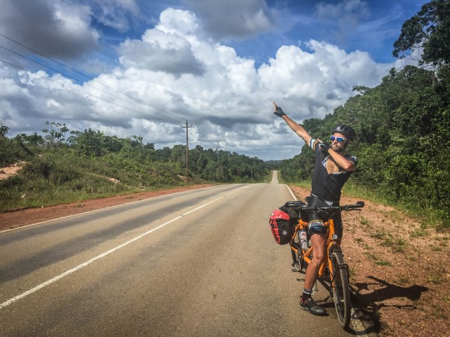 A male bicycle rider posing on a tandem bicycle in Suriname