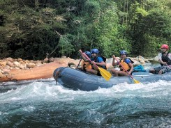 people doing white water rafting