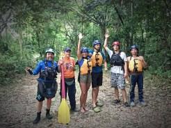 six people with kayak equipment