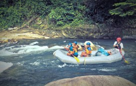 four people rafting in white water in Venezuela
