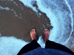 two feet at the beach