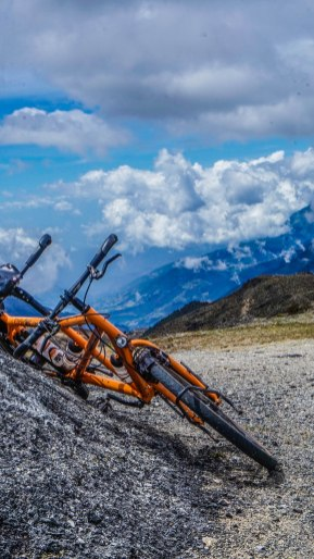 a tandem bicycle leaning on a rock in the mountains of Venezuela