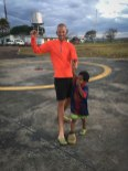 a laughing man and child on a helicopter base