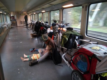 Family and bicycles in train