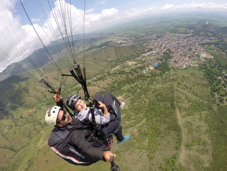 woman and man doing tandem paragliding