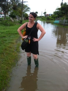 woman standing in the flooded street in Guyana