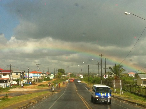 Busy street and rainbow in Guyana
