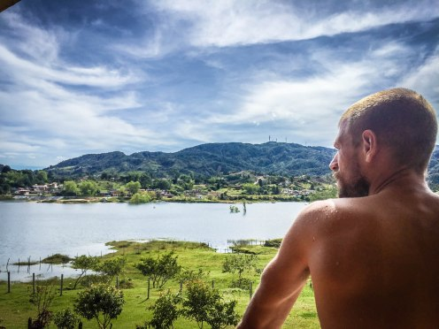 A man facing the Embalse Peñol in Guatapé, Colombia