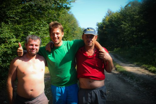 two Georgian men with a blonde German boy on a country road / Hitchhiking journey