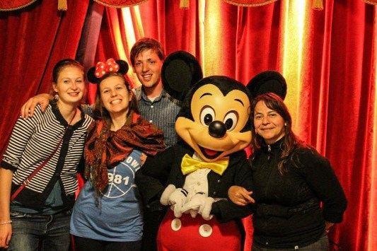 Mickey mouse in Disneyland Paris with three woman and one man