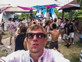 A blonde man with sunglasses at a psytrance festival