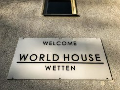 a sign which says World House Wetten