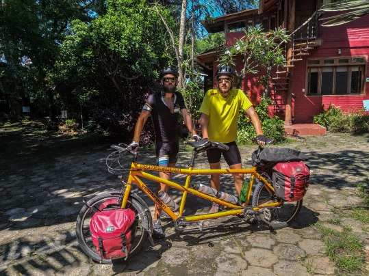 Two man holding a tandem bicycle in Ecuador