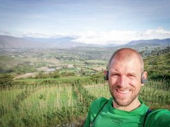 A with earphones on the countryside of Ecuador