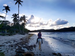 man riding a horse during sunset in the Dominican Republic