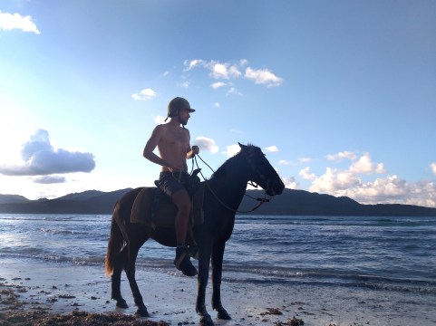 man horse riding at the beach in the Dominican Republic