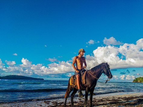 man on a horse at the sea
